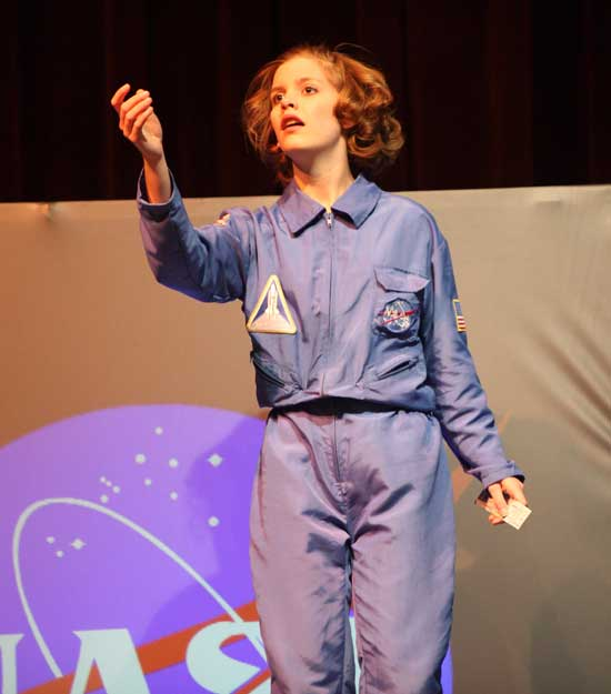 Senior Becca Turner portrays teacher-astronaut Christa McCauliffe in Defying Gravity.
